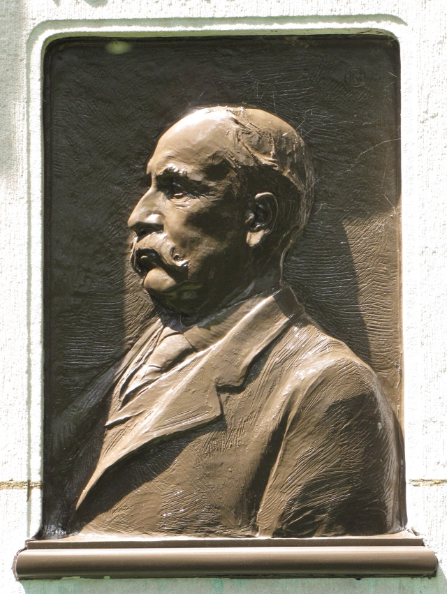 The bs-relief bronze of Henry Villard found on the back of his monument
