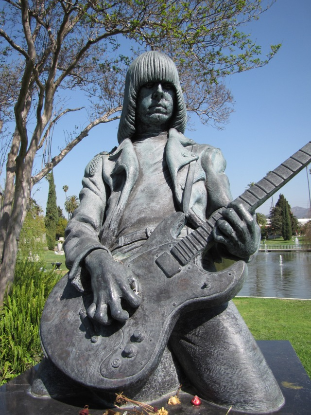 The sculpture of Johnny Ramones on top of his memorial in the Hollywood Memorial Park.