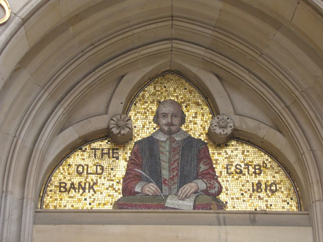 A mosaic of Shakespeare above a doorway into a Stratford bank